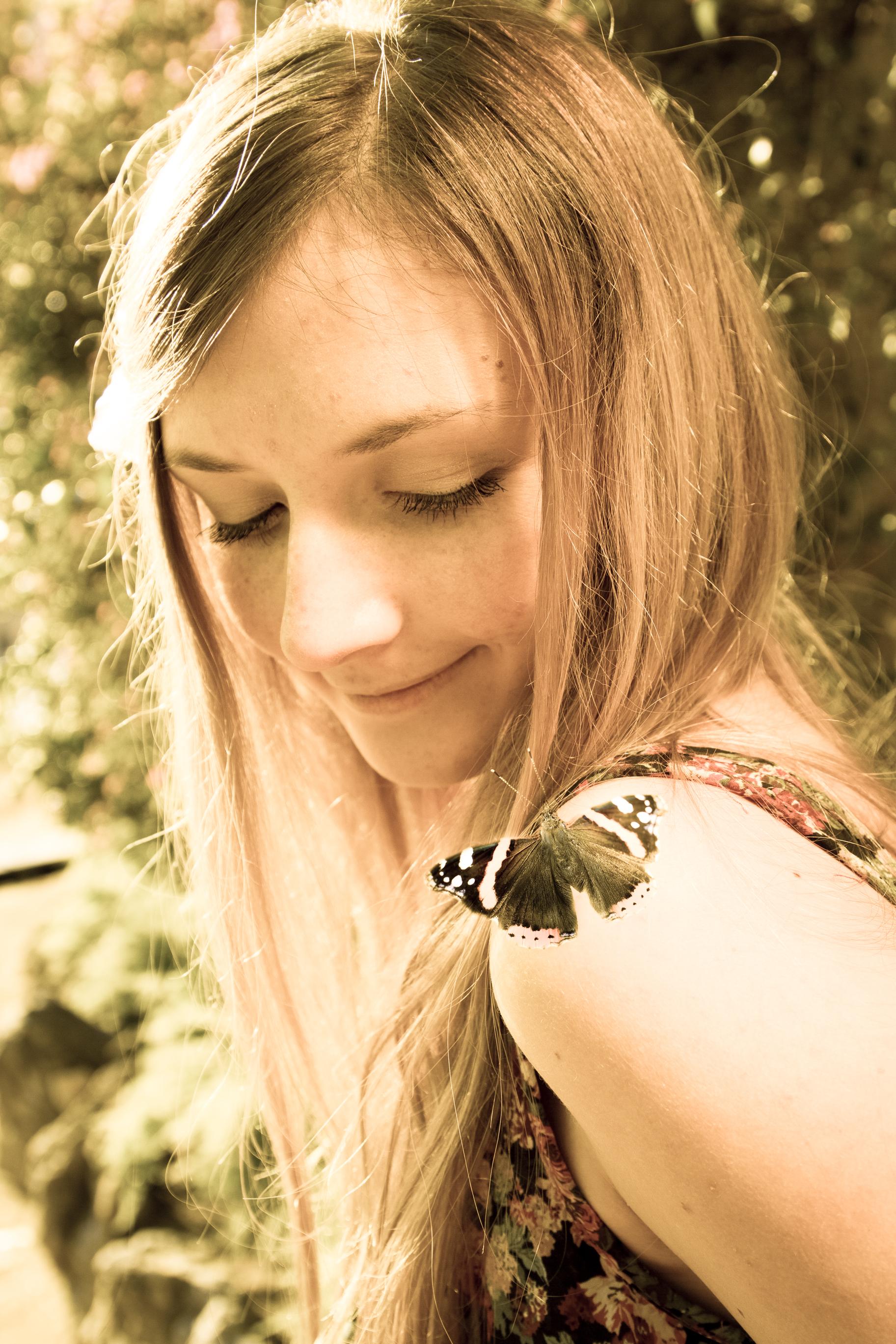 mariposa en hombro